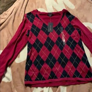 Size large sweater by Tommy Hilfiger.